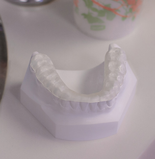 Nightgard use demonstrated on a model of teeth