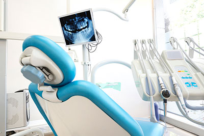 Dental chair in a dental office with a lot of bright light